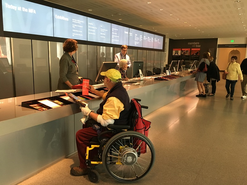 Man in wheelchair at museum.